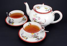 Tea time. Tea pot and two cups royalty free stock image