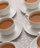 Tea time. A set of white tea cups against a neutral background Stock Image