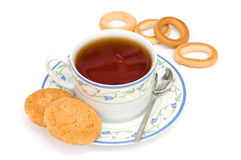 Tea time. A cup of tea,some bagels and owen biscuits isolated on white background Royalty Free Stock Images