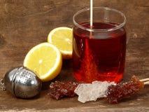 Tea Time. Black tea, lemon and sweet sugar Stock Images