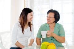 Tea time. Asian senior women and daughter having tea time Royalty Free Stock Image