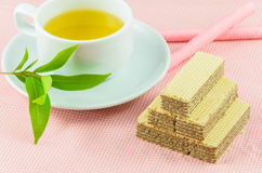 Tea time. Tea&biscuits on the pink table Royalty Free Stock Photo
