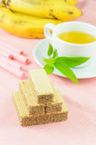 Tea time. Tea&biscuits on the pink table Royalty Free Stock Photography
