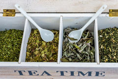 `TEA TIME` box with dried herbs Stock Image