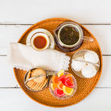 Tea time with candies and cookies. Royalty Free Stock Photo