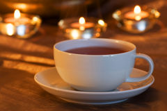 Tea time with candle light Royalty Free Stock Image