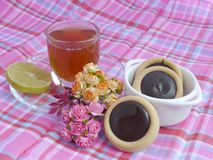 Tea Time. Chocolate cookies and tea royalty free stock photography