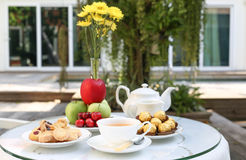 Tea time with chocolate and cookies or biscuit and fruit Stock Images