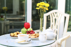 Tea time with chocolate and cookies or biscuit and fruit Royalty Free Stock Photo