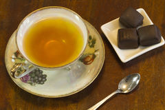 Tea Time and Chocolate. Tea served with chocolate truffles and aroma therapy Royalty Free Stock Images