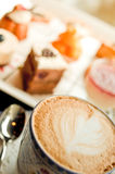 Tea time with coffee and cakes Royalty Free Stock Images
