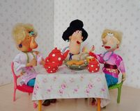 Tea time. Cold porcelain clay sculpted puppets Stock Photo
