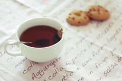Tea time and cookie with chocolate chips. A still-life of some breakfast essentials stock photography