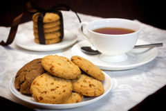 Tea time with cookies Stock Photos