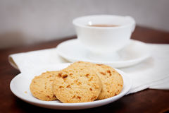 Tea time with cookies. A cup of tea with cookies Royalty Free Stock Photography