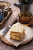 Tea time with crackers Stock Images