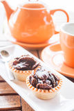 Tea time with crispy chocolate tarts Stock Images