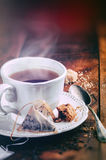 Tea time. Cup of black tea. And cookie Royalty Free Stock Photography