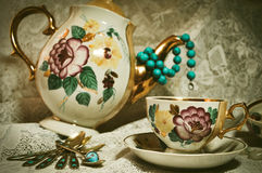 Tea-time. Cup,glassware,saucer,beads,decoration,white cloth,flower,dishes,dinner set Royalty Free Stock Images