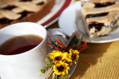 Tea time. A  cup of tea with a slice of cake  - tea time or breakfast concept Royalty Free Stock Images