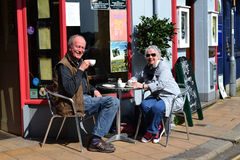 Tea time in Totnes, Devon, England. This couple is enjoying a cup of tea at the Barrow House in Totnes U.K Royalty Free Stock Photos