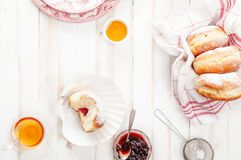 Tea time with festive sufganiyot donuts filled with jelly Royalty Free Stock Images