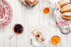 Tea time with festive sufganiyot donuts Royalty Free Stock Photo