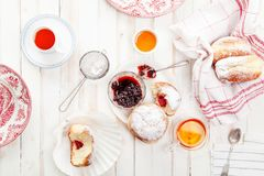 Tea time with festive sufganiyot donuts Stock Photography