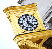 Tea time - five o'clock. Golden clock at five o'clock - tea time in UK. Photo taken in Leeds Royalty Free Stock Photo