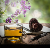 Tea time with heart gift, notebook and pen on wooden table Stock Photo