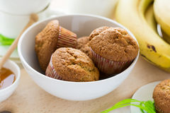 Tea time: homemade banana muffins, honey, bananas and tea settings Royalty Free Stock Photo