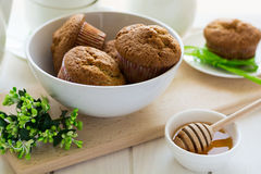 Tea time: homemade banana muffins, honey, bananas and tea settings Royalty Free Stock Images