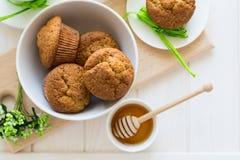 Tea time: homemade banana muffins, honey, bananas and tea settings Royalty Free Stock Photography