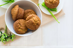 Tea time: homemade banana muffins, honey, bananas and tea settings Royalty Free Stock Photos