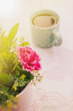 Tea time, Hot tea with artificial flower Royalty Free Stock Photography