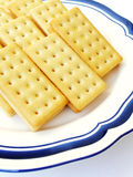 Tea Time with Lemon cream biscuits. A plate of delicious and crunchy looking biscuits with lemon cream sandwiched between two slices.  Appetizing golden yellow Stock Photo