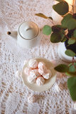 Tea time. Lunch with hot tea and diet dessert white and pink mar Royalty Free Stock Image