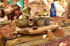 Tea Time in the Middle East. Mint tea is served in a traditional manner after an outdoor lunch in the Middle East Stock Image