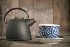 Tea time. Minimal tea time on wooden background Royalty Free Stock Images
