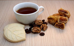 Tea. Time with nuts on table Stock Photography