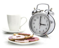 Tea Time old style clock. With cup of tea and biscuits Royalty Free Stock Image