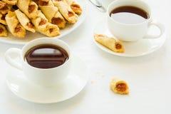 Tea time with Polish cream cheese cookies  Kolacky with apple jam Royalty Free Stock Photos