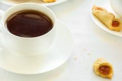 Tea time with Polish cream cheese cookies  Kolacky with apple jam Stock Photos
