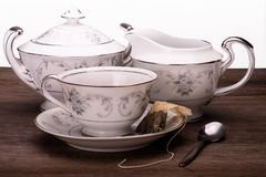 Tea time trio of teacup, creamer and sugar bowl royalty free stock image