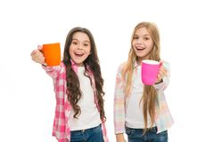 It is tea time. Relaxing with drink. Tea break. Children do not drink enough during school day. Make sure kids drink. Enough water. Girls kids hold cups royalty free stock photo