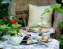 Tea time with scones, jam and double cream. In the garden Royalty Free Stock Photo