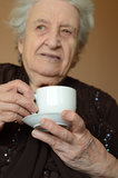 tea time for a senior woman Royalty Free Stock Images