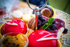 Tea time set with many desserts royalty free stock photography