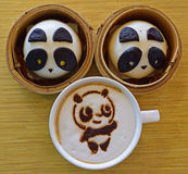Tea Time Snack with Panda Bun and Coffee. The Chinese Pau and Coffee are beautifully decorated with Panda theme. Everything Anything Panda. Crazy, madly in Royalty Free Stock Photos