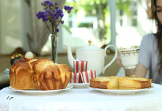 Tea time with sweet bread and muffin, apple tart and fruit Stock Image